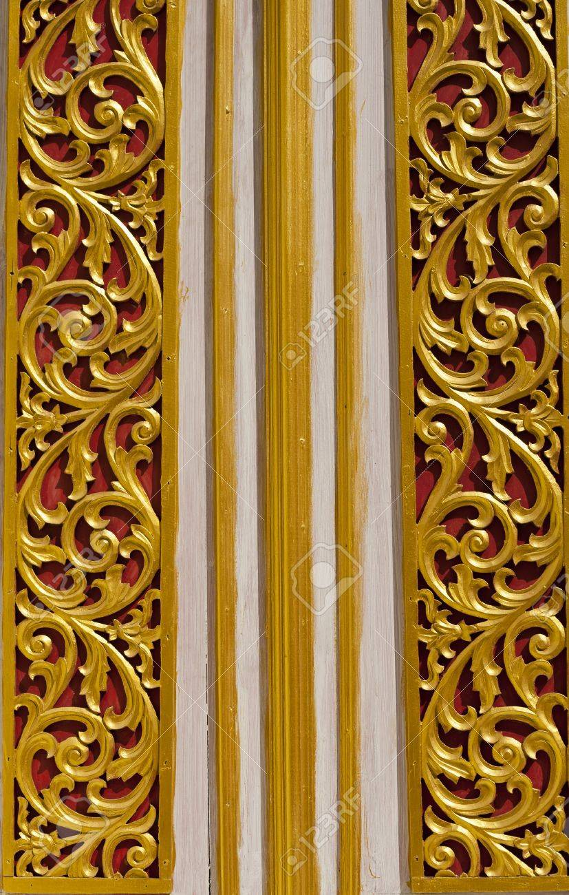 Wooden Thai style carving on the door of temple Stock Photo - 12007270