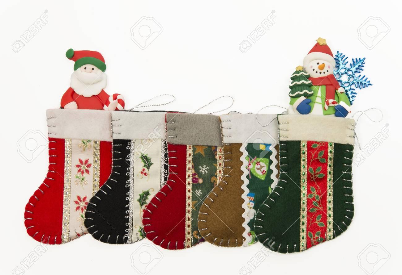 Arrange of Christmas sock with Santa and Snow man Stock Photo - 16689326