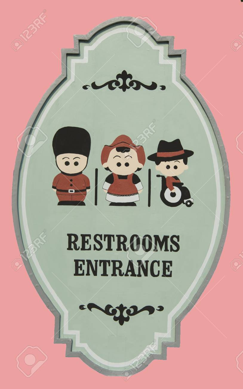 Restroom entrance sign isolated on pink background Stock Photo - 18594969