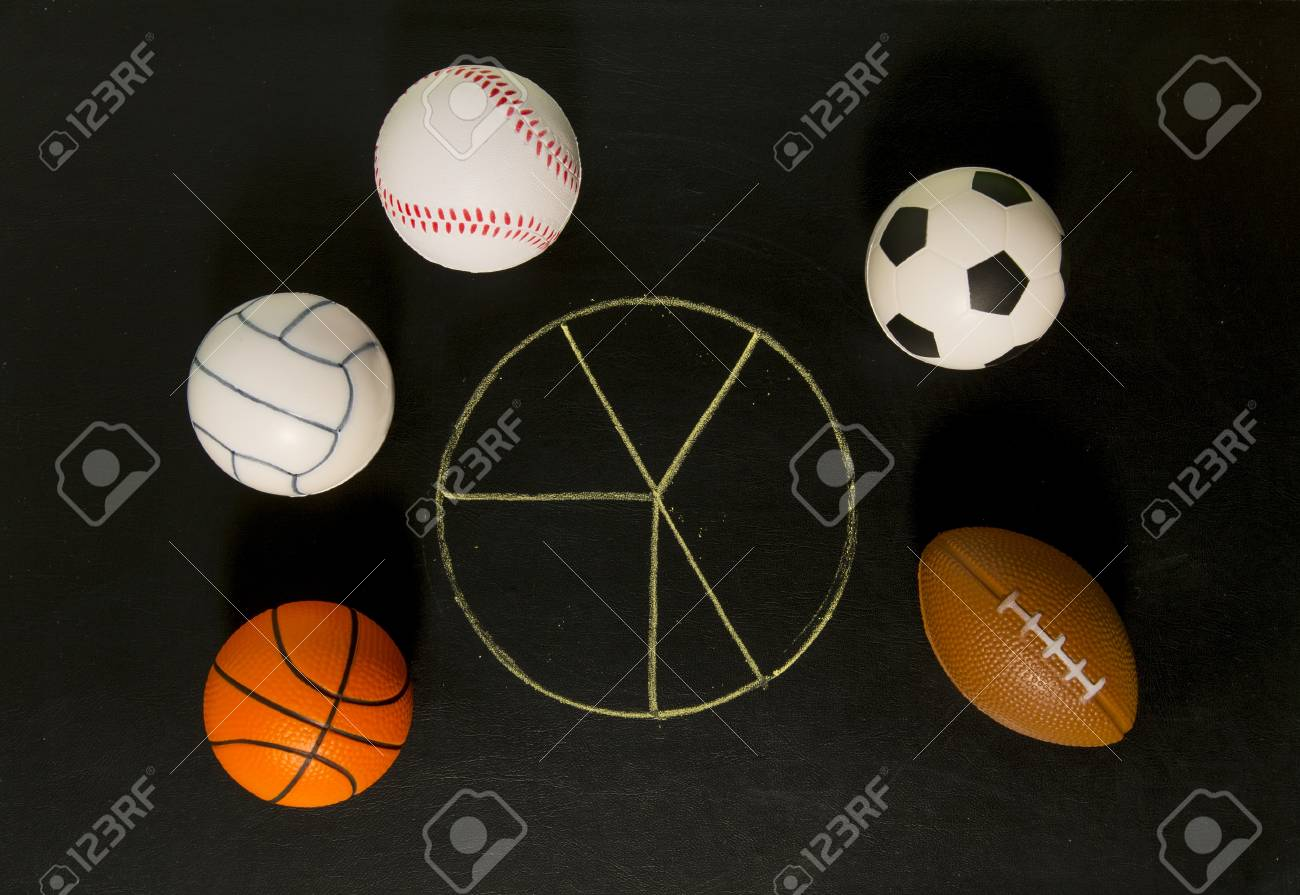 Blank pie chart around with balls in black background Stock Photo - 19835392