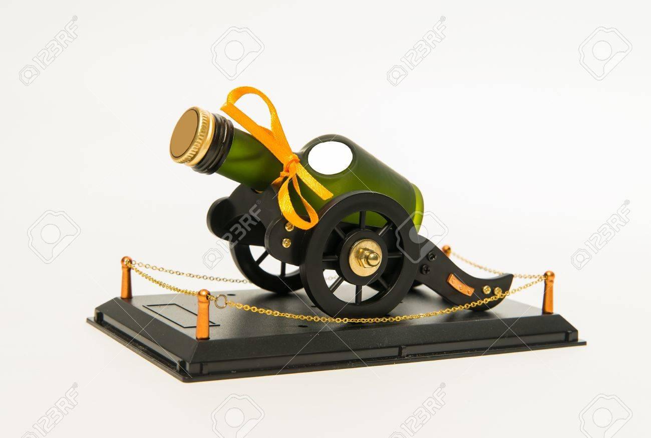 Green whisky bottle in cart wheel platform Stock Photo - 21075810