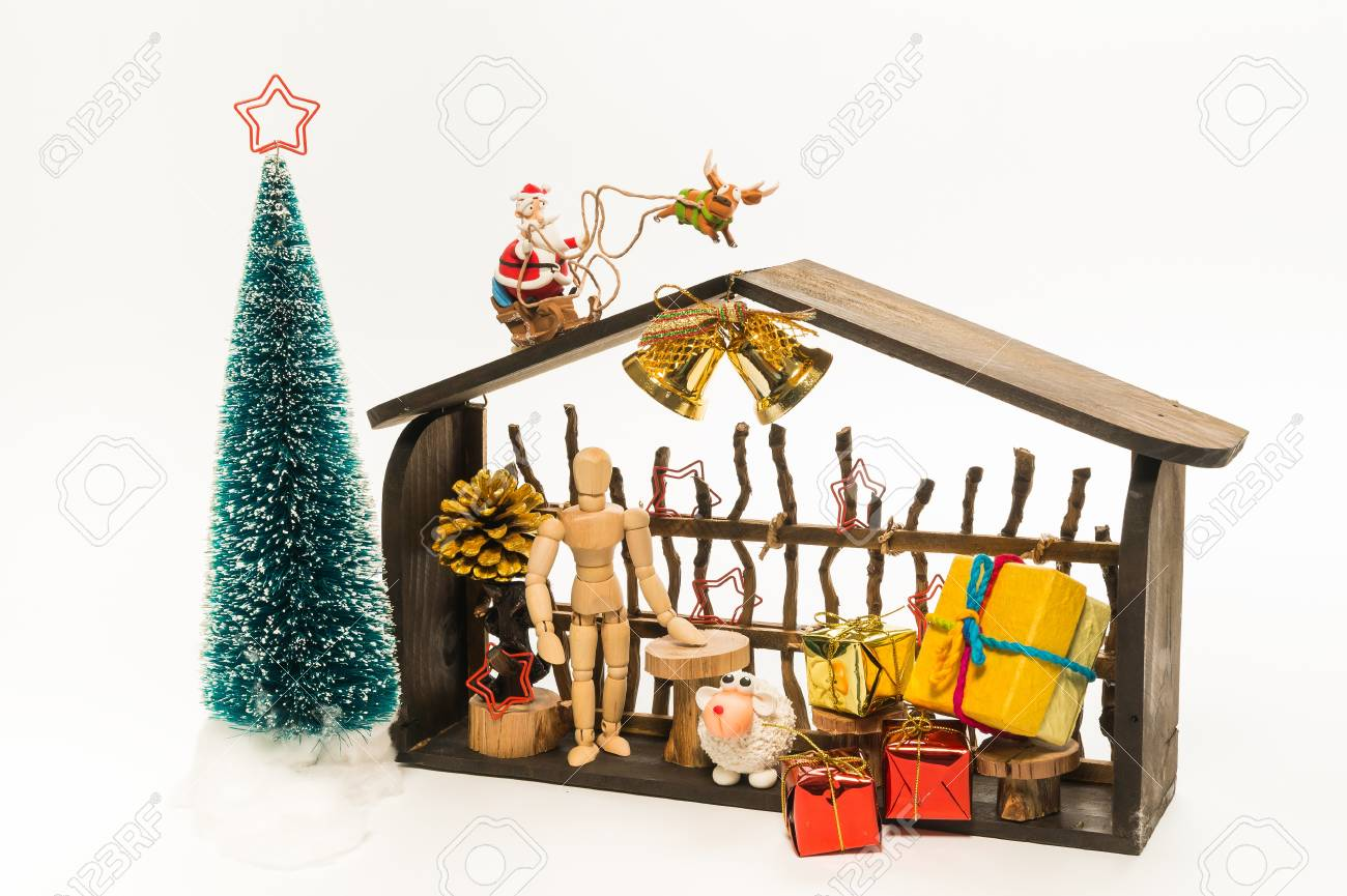 Wooden Christmas shop with Santa and raindeer isolated on white background Stock Photo - 21069267