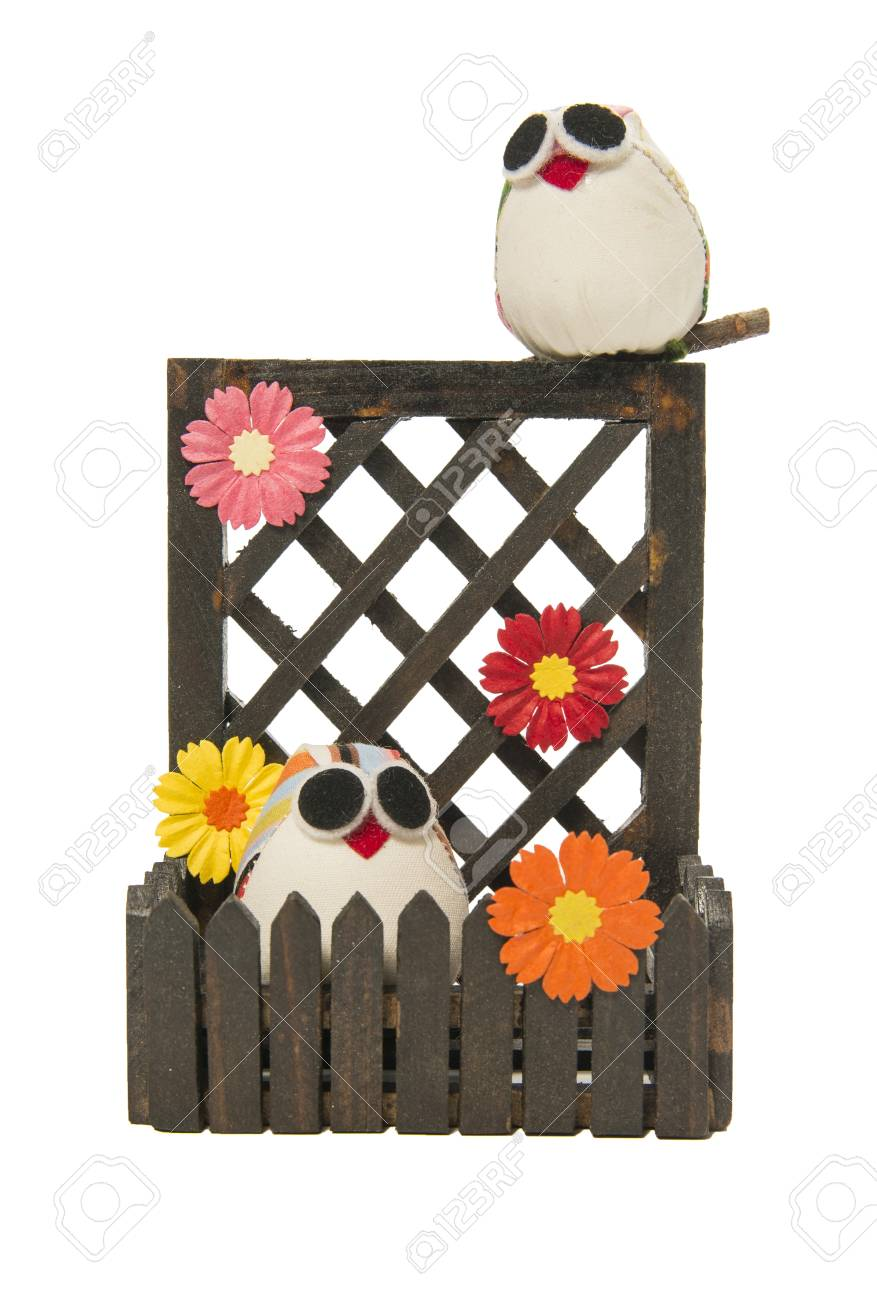 Couple owl with flower on the wooden fence Stock Photo - 21493059