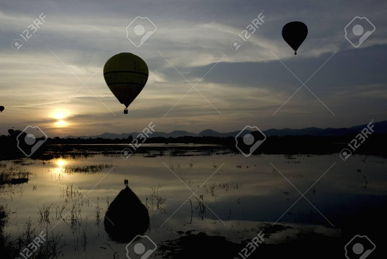 Balloon at sunset above the lake Stock Photo - 16174726