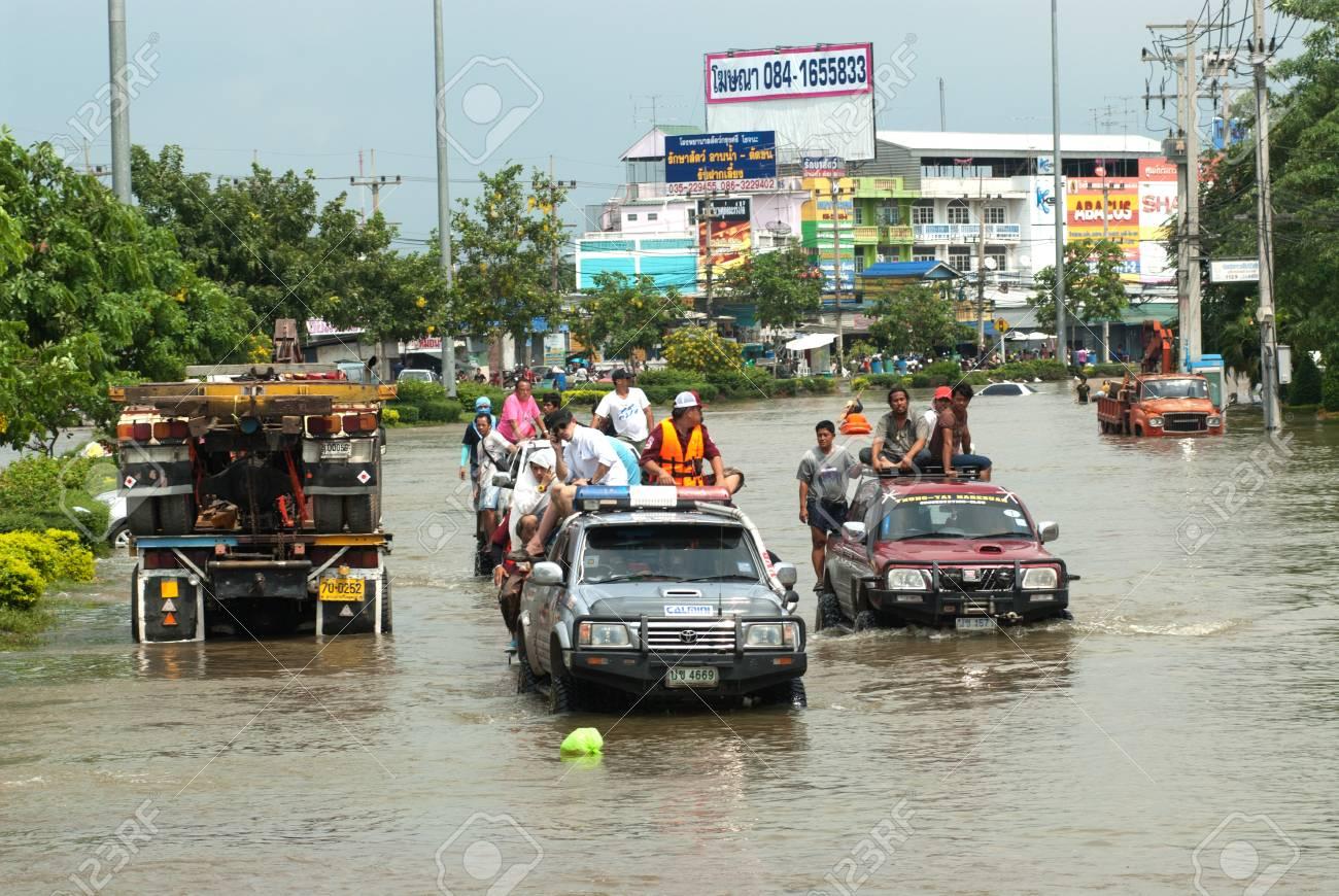 AYUTTHAYA, THAILAND - OCTOBER 9  Heavy flooding from monsoon rain in Ayutthaya and north Thailand arriving in Ayutthaya suburbs on October 9, 2011 in Ayutthaya, Thailand  Stock Photo - 16680395
