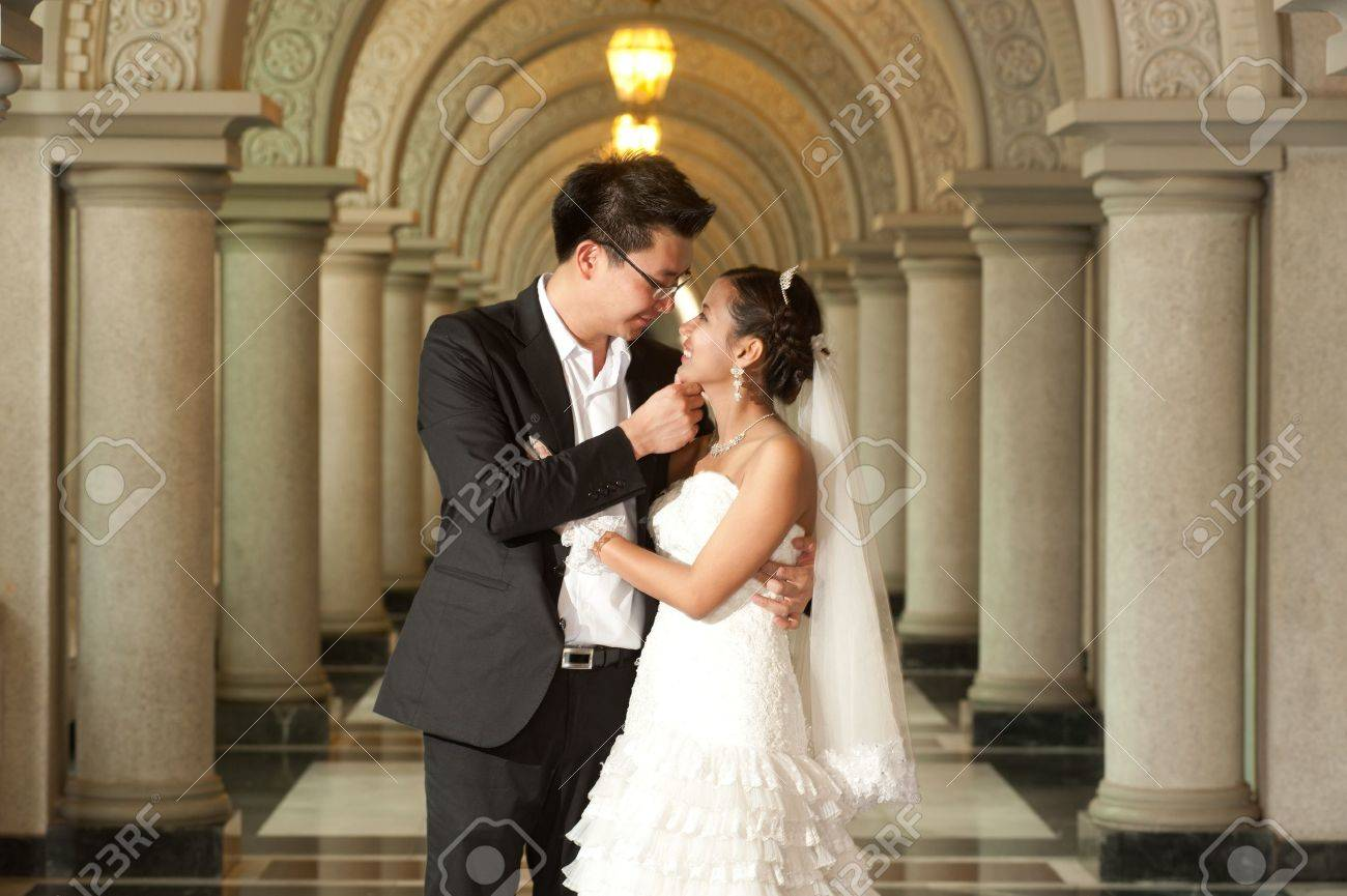 A Beautiful Asian Bride And Handsome Groom At Christian Church ...