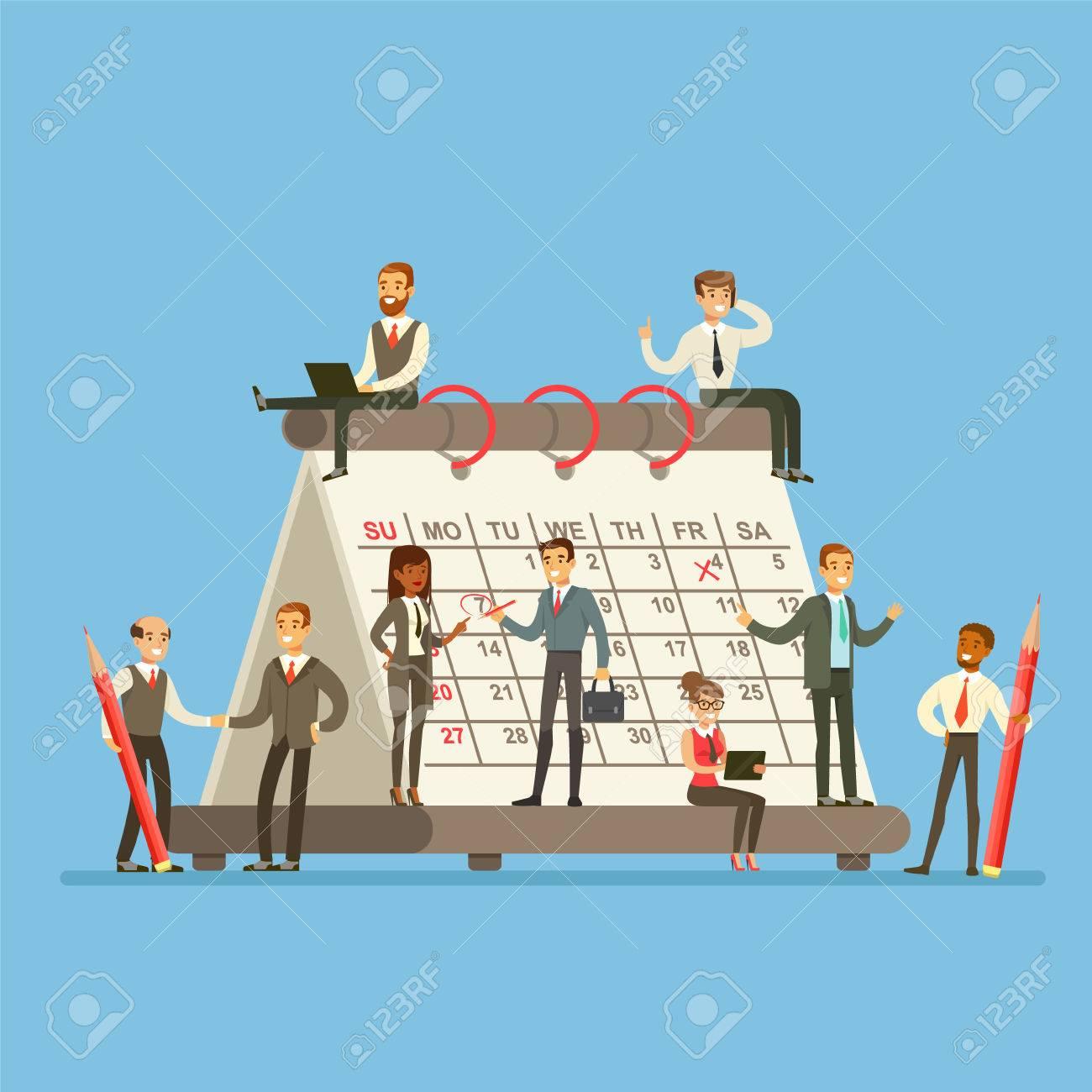 Calendrier Geant.Personnes Qui Travaillent Dans Une Entreprise Autour D Un Calendrier Geant Parler Discuter Et Planifier La Strategie
