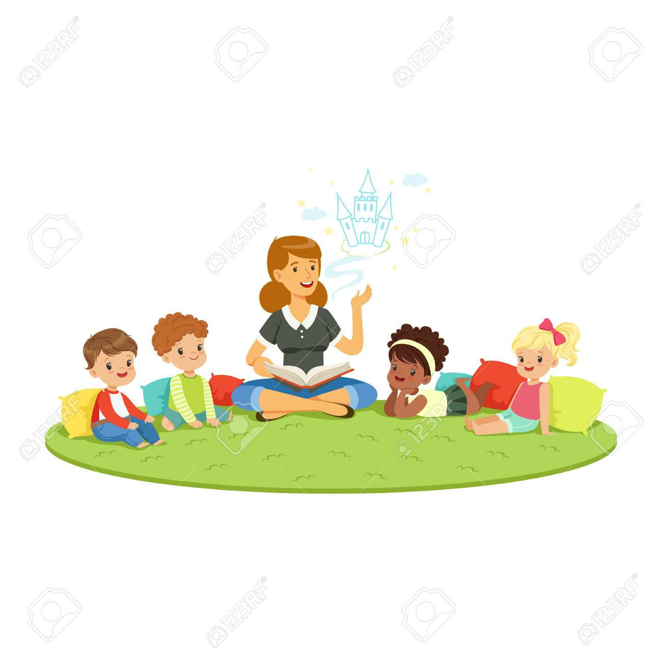 teacher reading a fairytale to kids while sitiing on a carpet