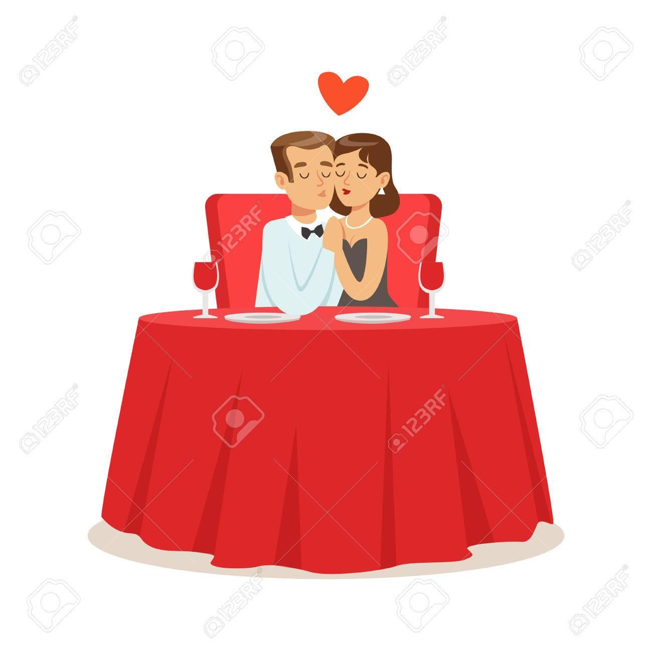 恋カフェの抱擁で座っている幸せなカップルは、ロマンチックな日付の