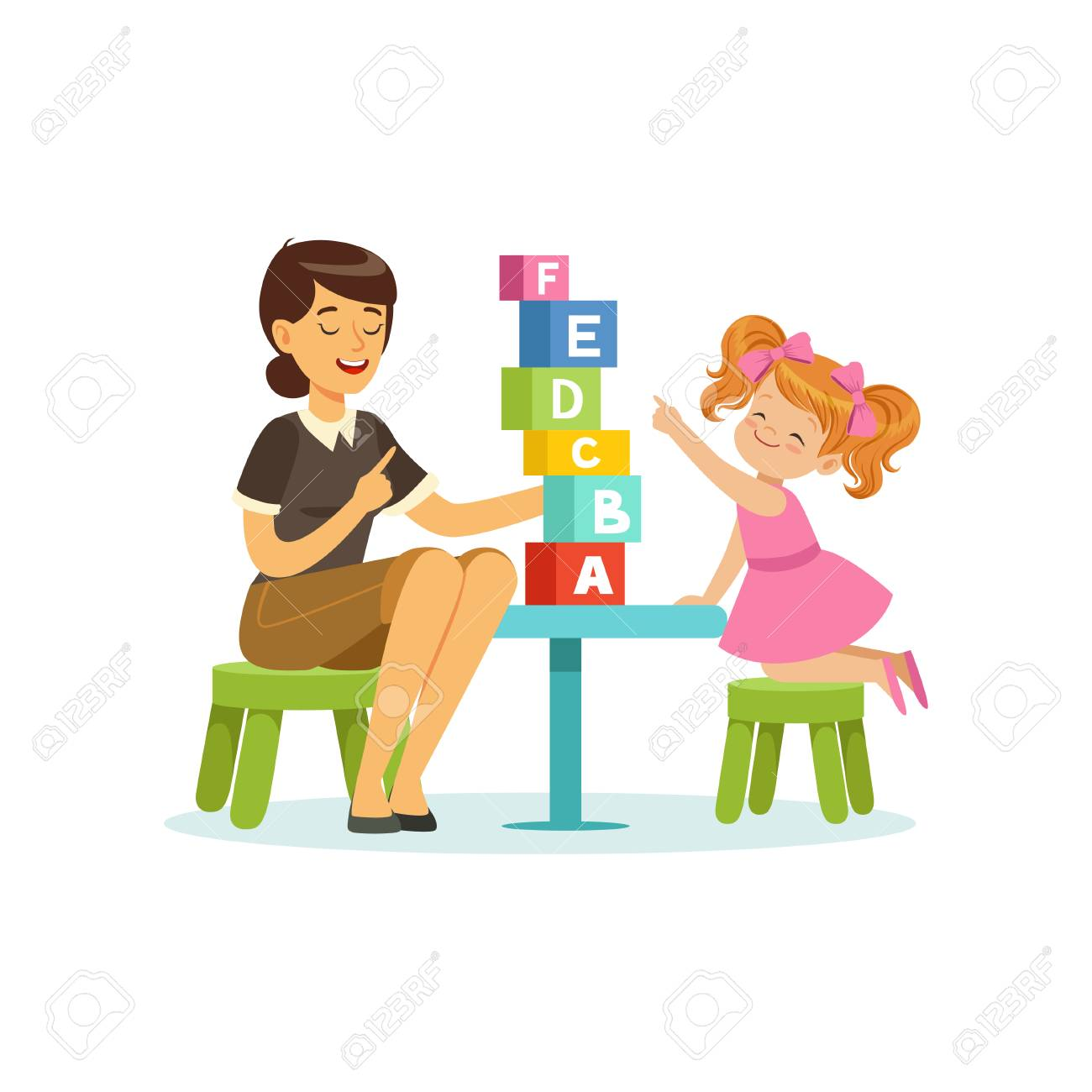 Cute little girl learning alphabet letters through play with speech therapist. Educational game concept - 90329309