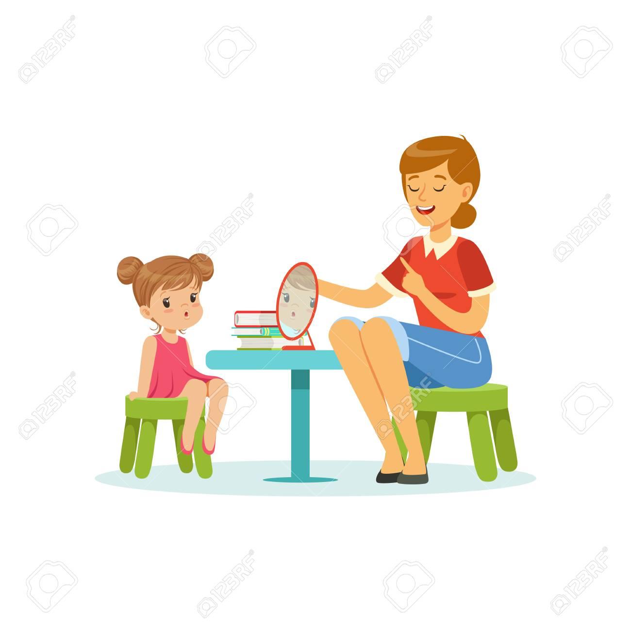 Speech and language specialist teaching little girl correct pronunciation of letters. Child speech sound development - 90329219