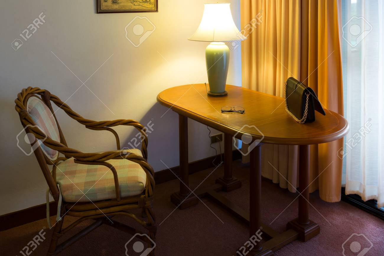 furniture inside to home, chair with table and lamp is the vintage style and luxurious interior for working Stock Photo - 25219961