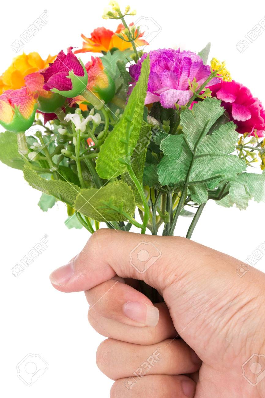 the isolated bouquet of fake flower is give to rose colorful with hand on white background
