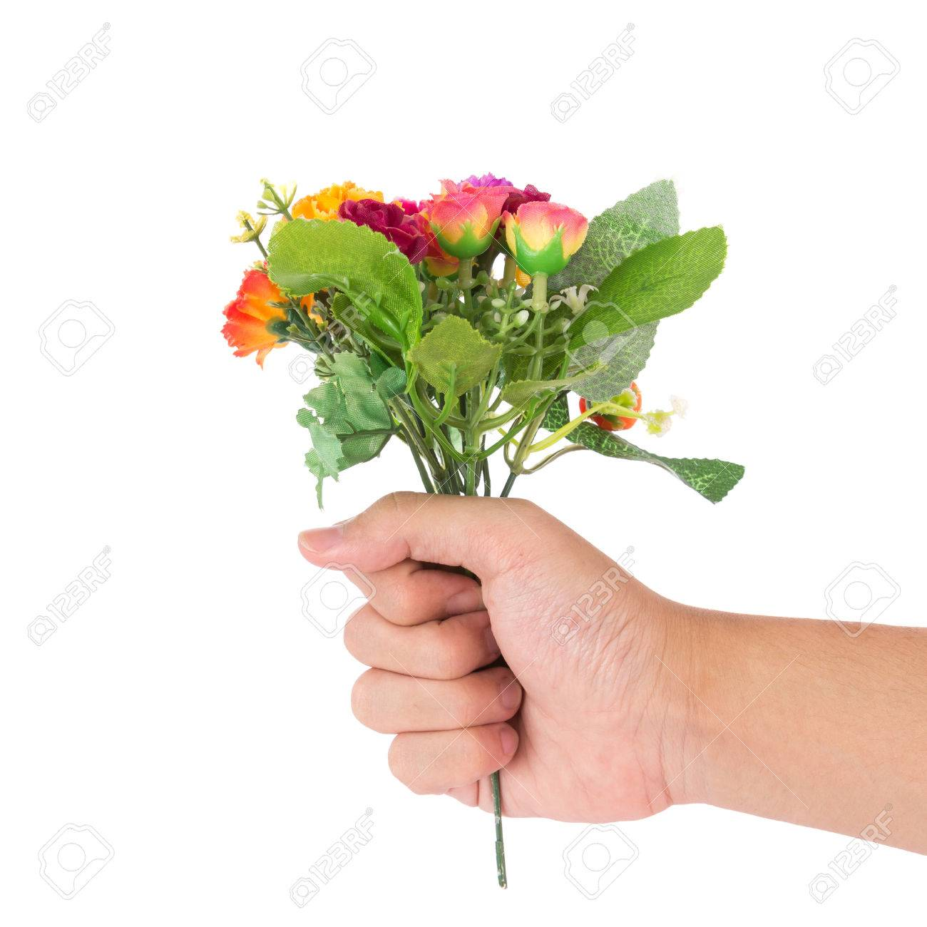 The isolated bouquet of fake flower is give to rose colorful stock stock photo the isolated bouquet of fake flower is give to rose colorful with hand on white background izmirmasajfo Images