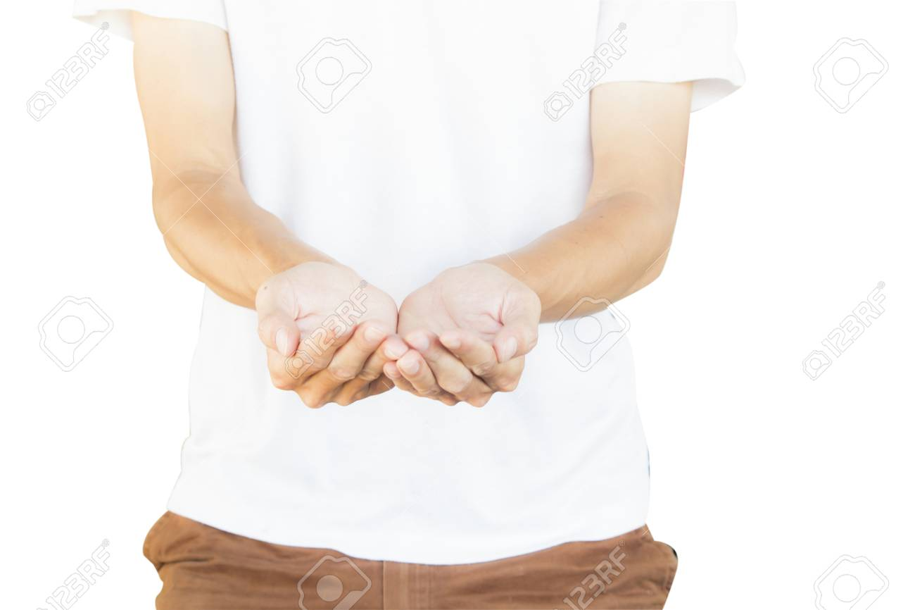 man wearing white shirt and brown pants making hand gesture like a holding something isolated on
