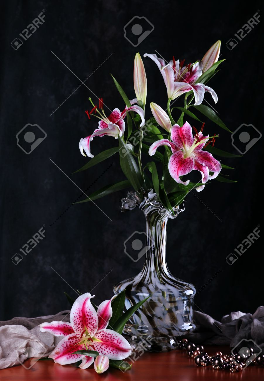 Still life with pink lily flowers in a glass vase stock photo still life with pink lily flowers in a glass vase stock photo 15136060 reviewsmspy