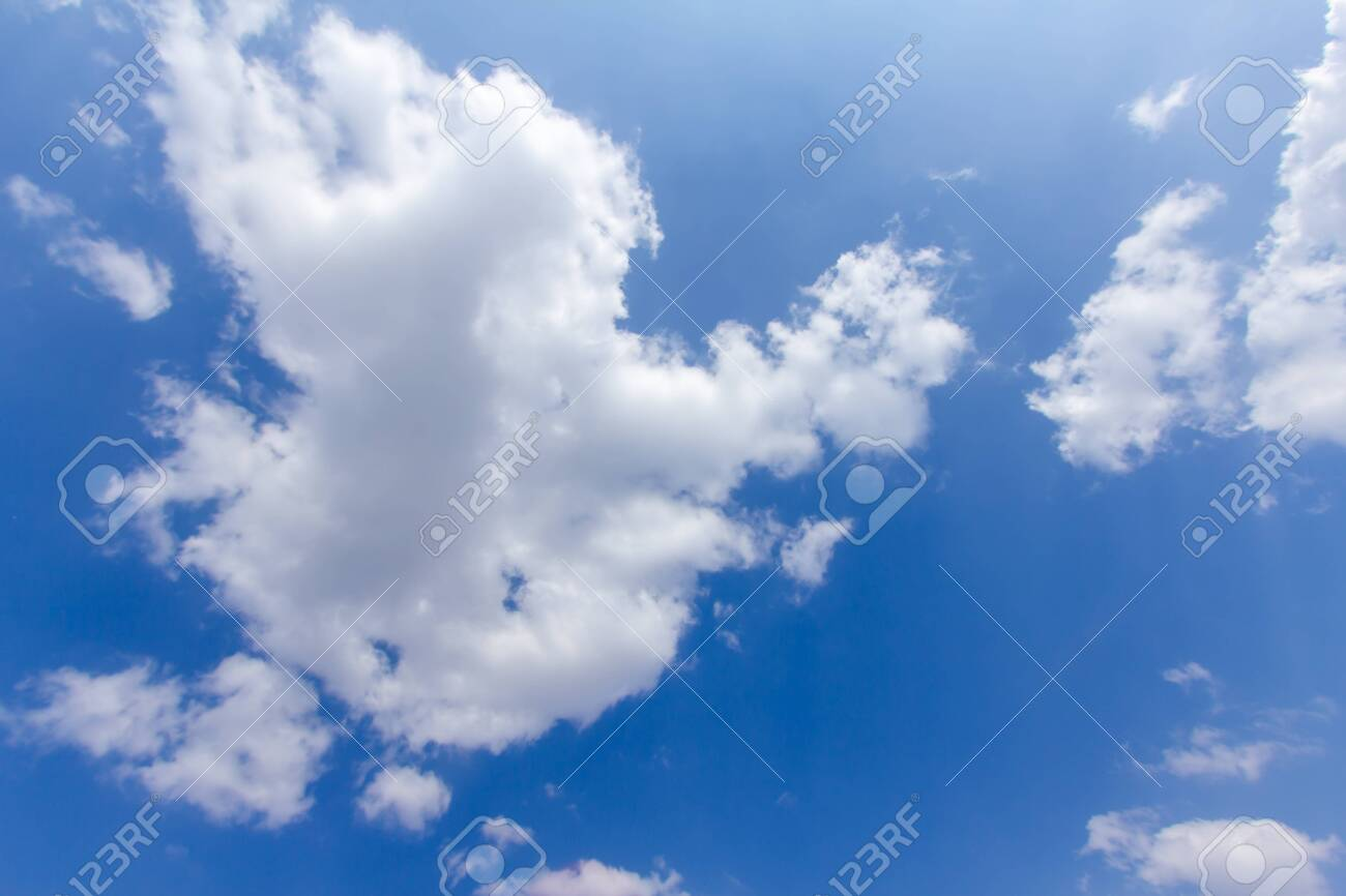 blue sky background with a tiny clouds - 122577757