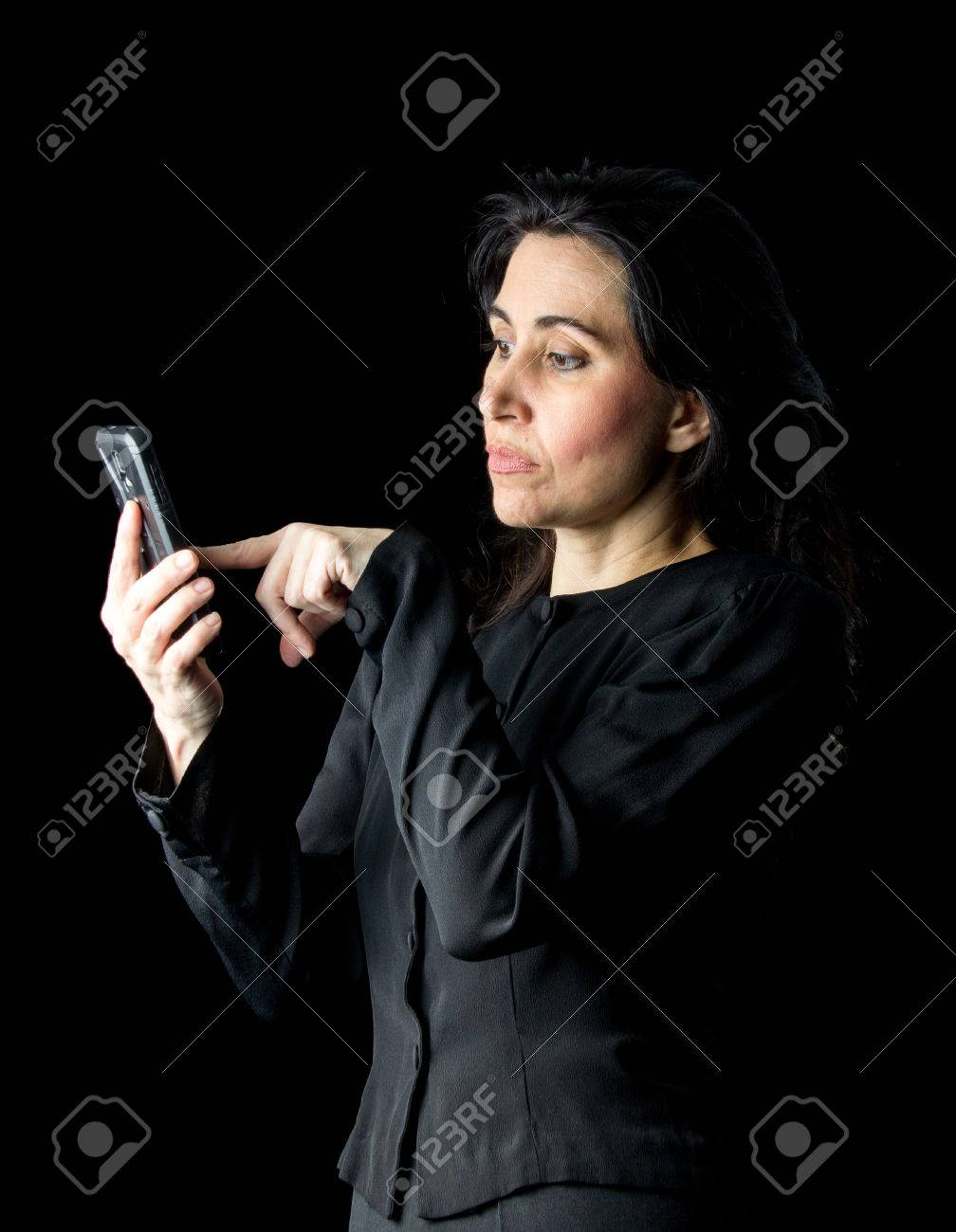 22c5db88d Brunette woman in black dress and black gloves standing in front..