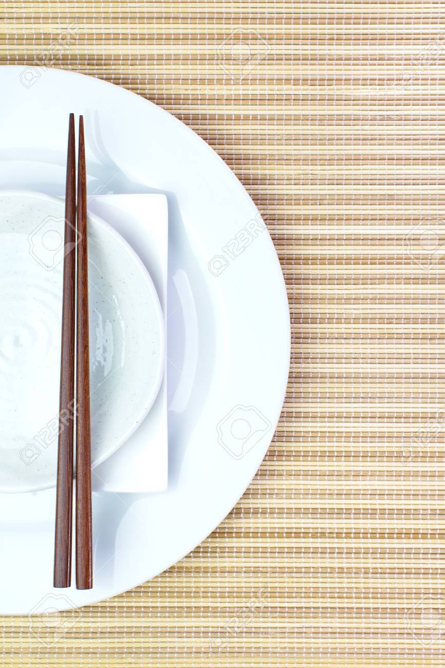 Chopsticks And Asian Table Setting Stock Photo