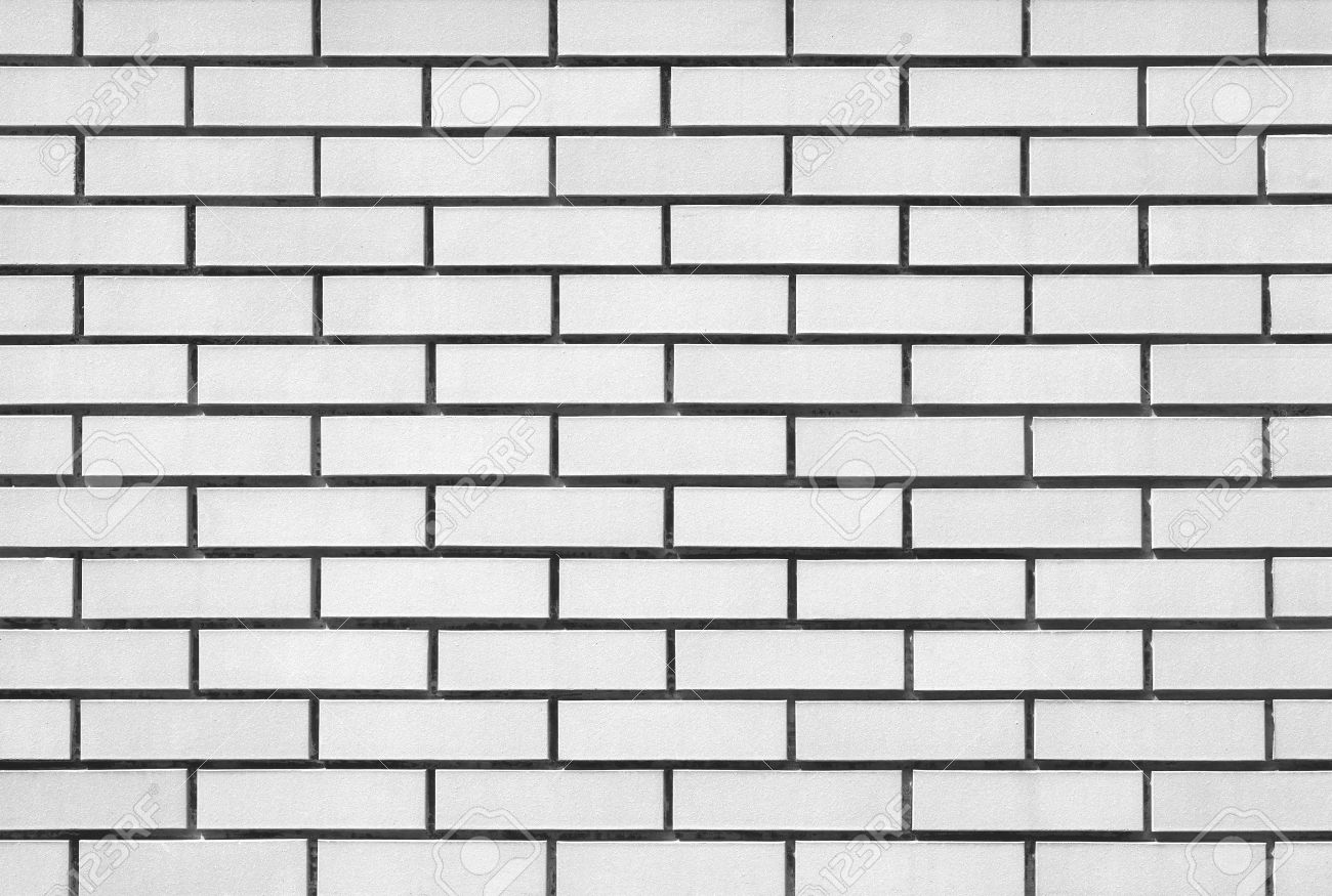 white brick modern wall background and texture stock photo