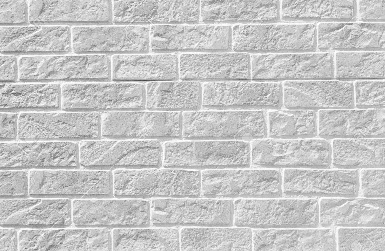 white brick stone wall seamless background and texture stock photo