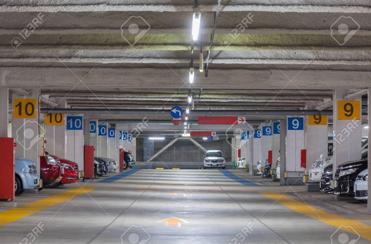 Parking garage underground interior, neon lights at night - 51995762