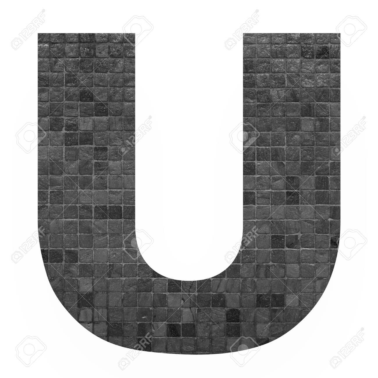 english alphabet letter u with black mosaic background photo.. stock