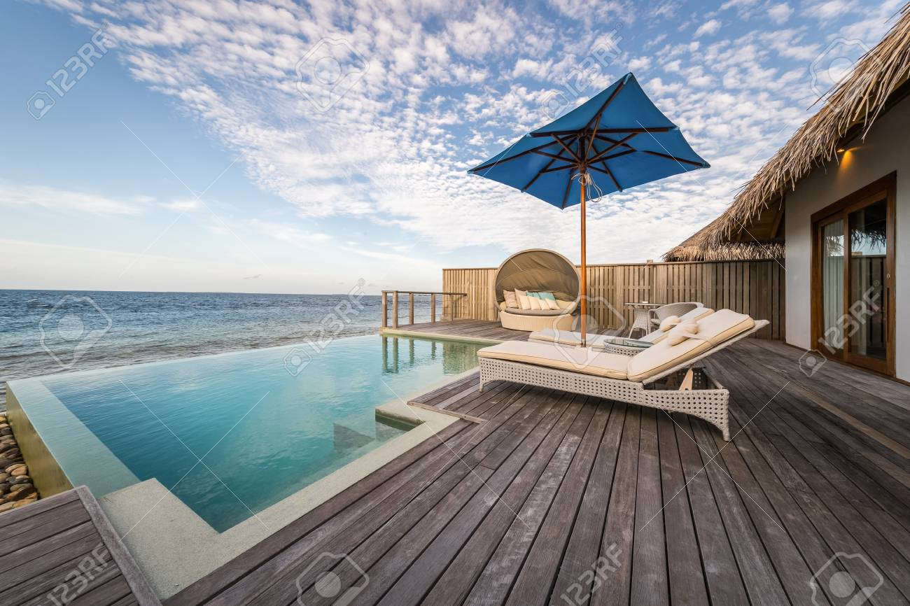 Outdoor swimmimg pool and blue sea - 102167231