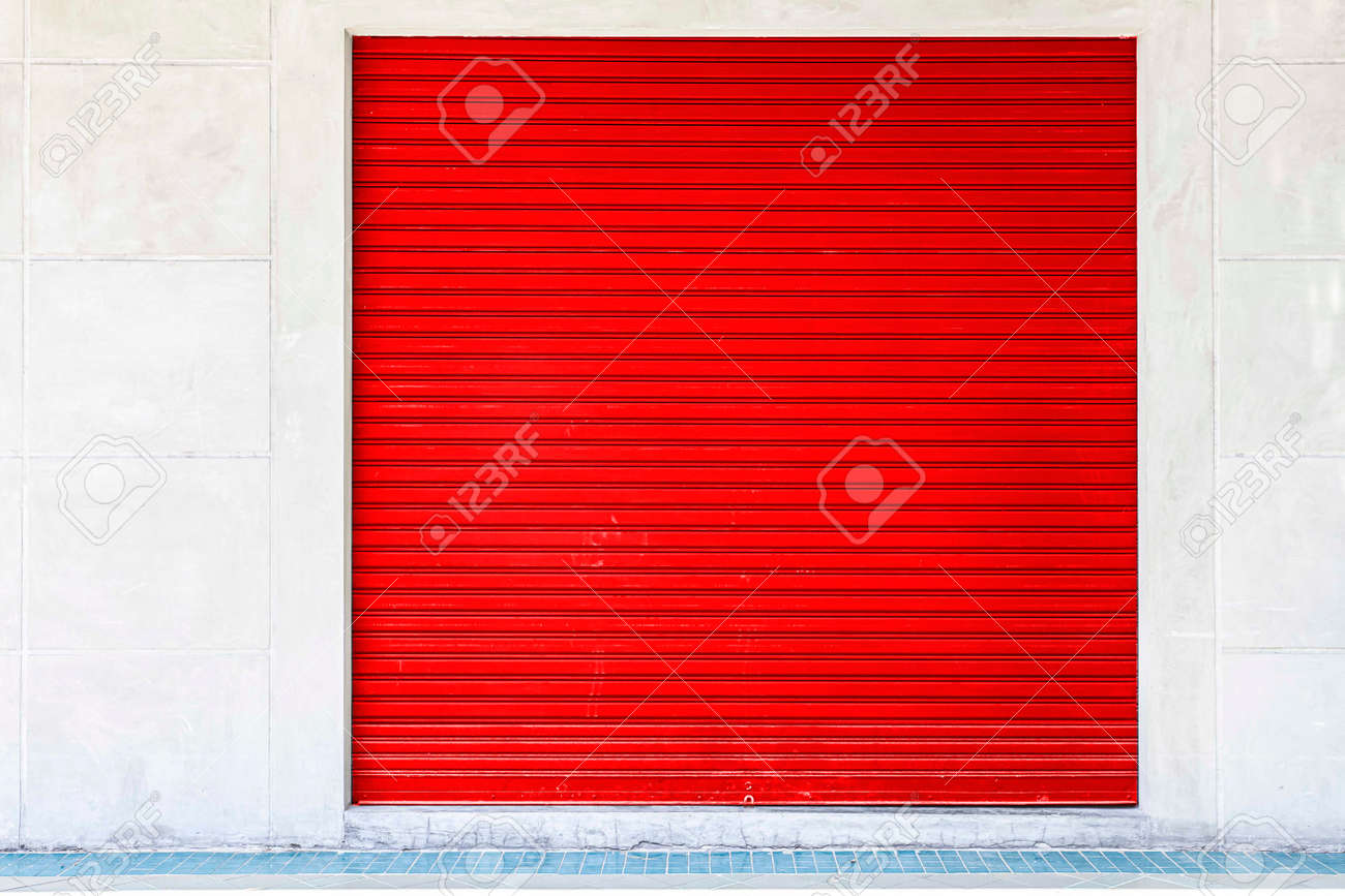 The red roller shutter door of the store is closed - 168475619