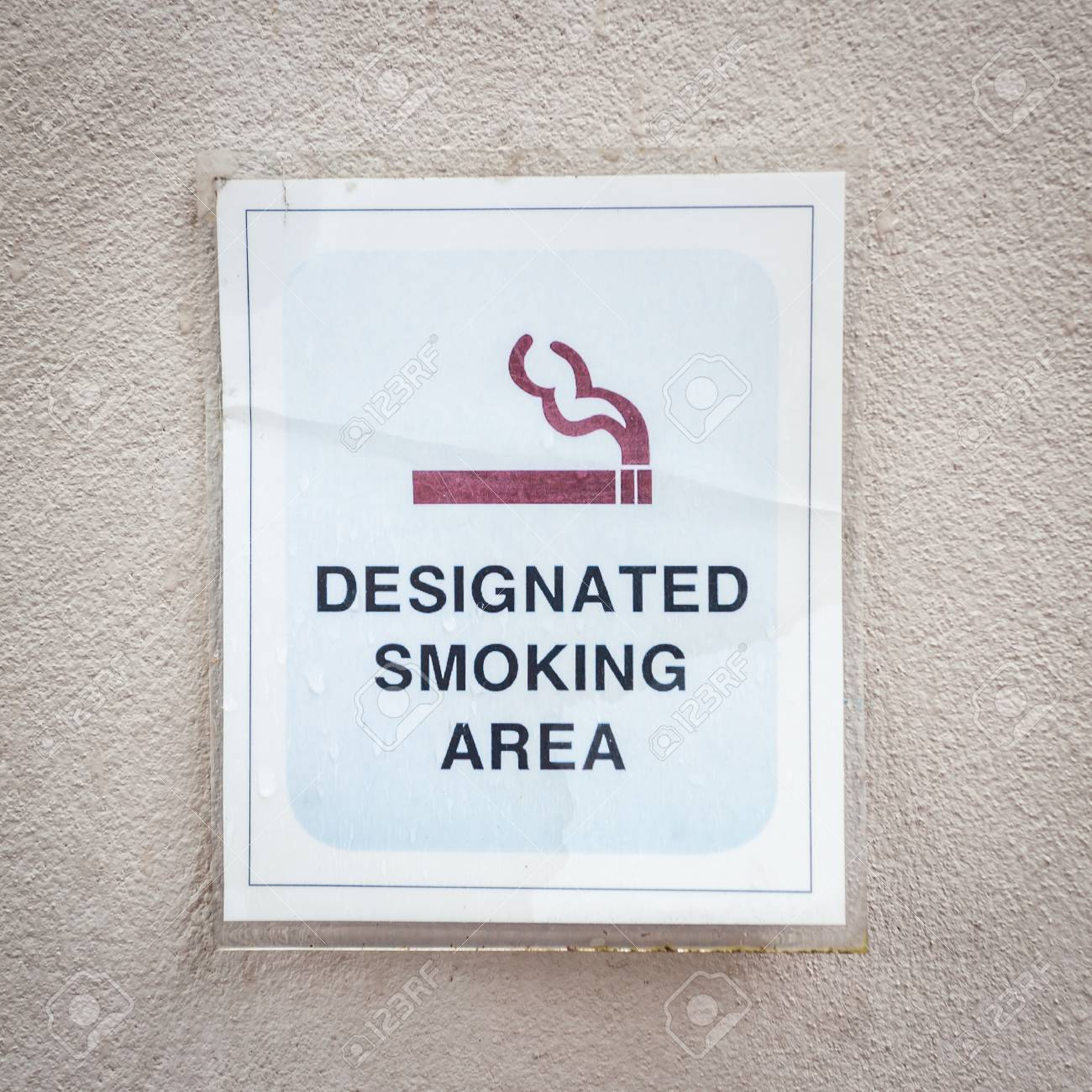 Tag for designated smoking area on wall Stock Photo - 22975577