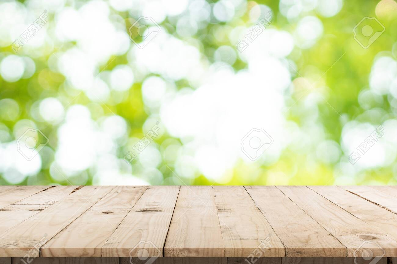 abstract blurred garden and green leaf with wooden table counter background for show , promote ,design on display concept - 146032193