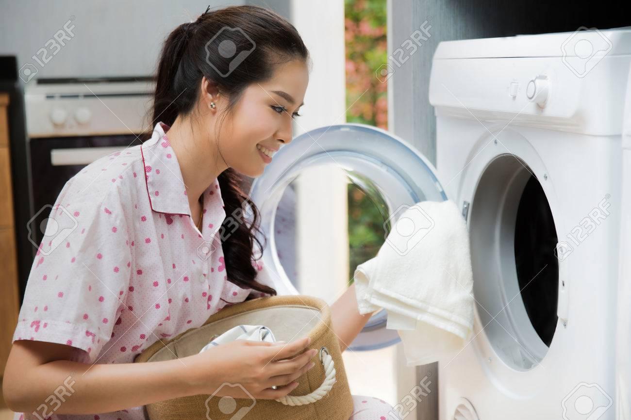 Women washing clothes The washing machine - 61912813