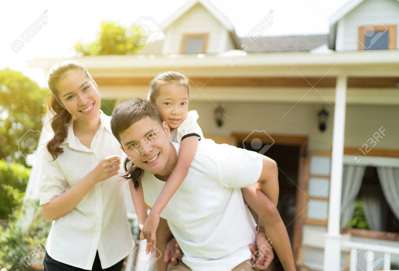 Asian family portrait with happy people smiling at home - 81842036
