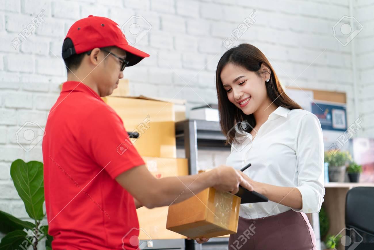 business woman receiving a parcel - 123514057