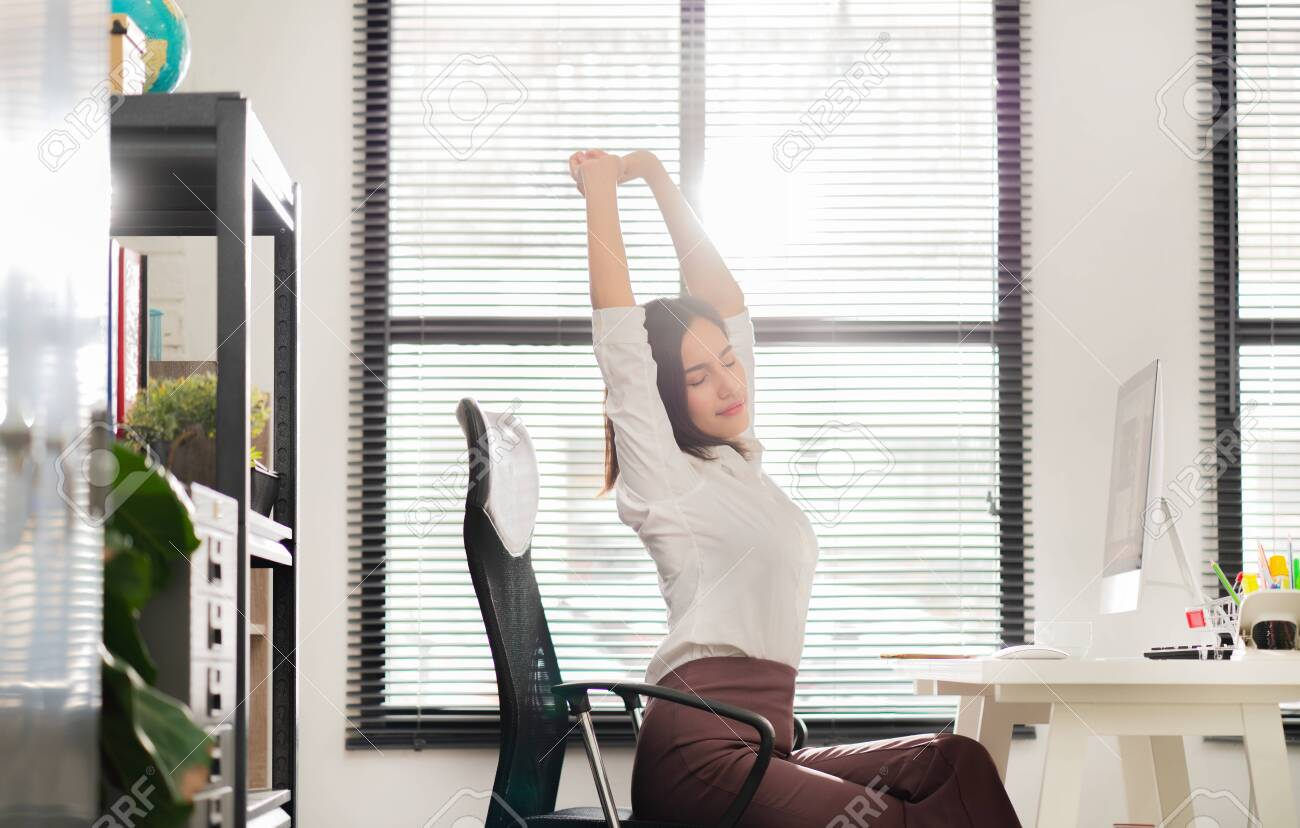 Asian working woman relaxed from work, she was glad. - 123514066