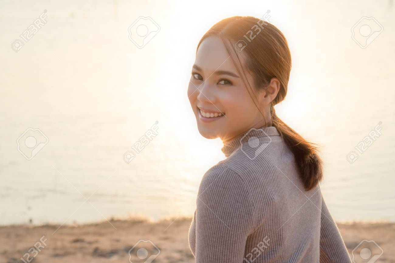 Asian carefree woman on the beach - 120404678