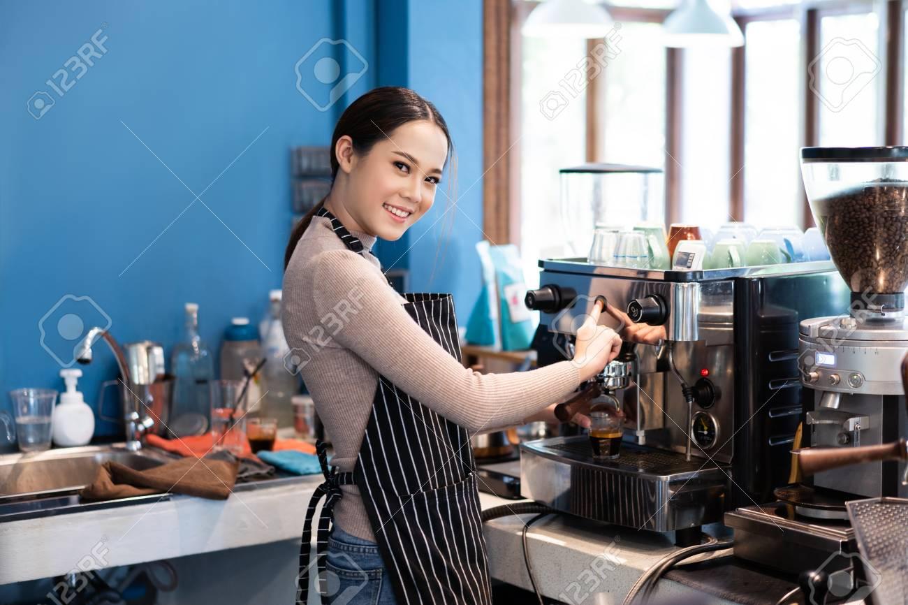 Barista asian woman making coffee in a shop - 120404335