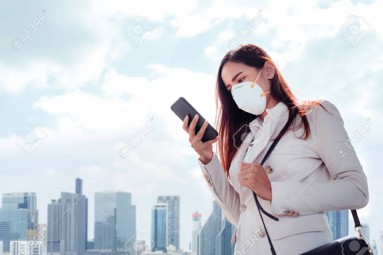Asian woman are going to work.she wears N95 mask.prevent PM2.5 dust and smog - 130051725