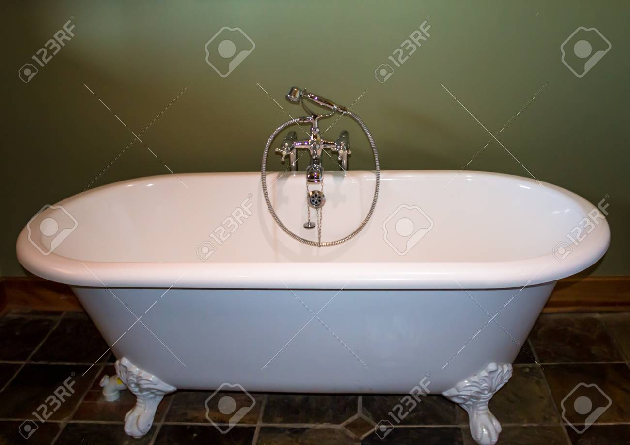 White Luxury Roll Top Bath Tub Against Olive Green Background Stock ...