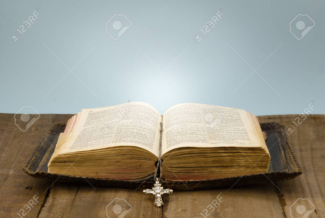 Old Leather Covered Holy Bible On Rough Wood Table With Crystal Cross Book  Mark Stock Photo