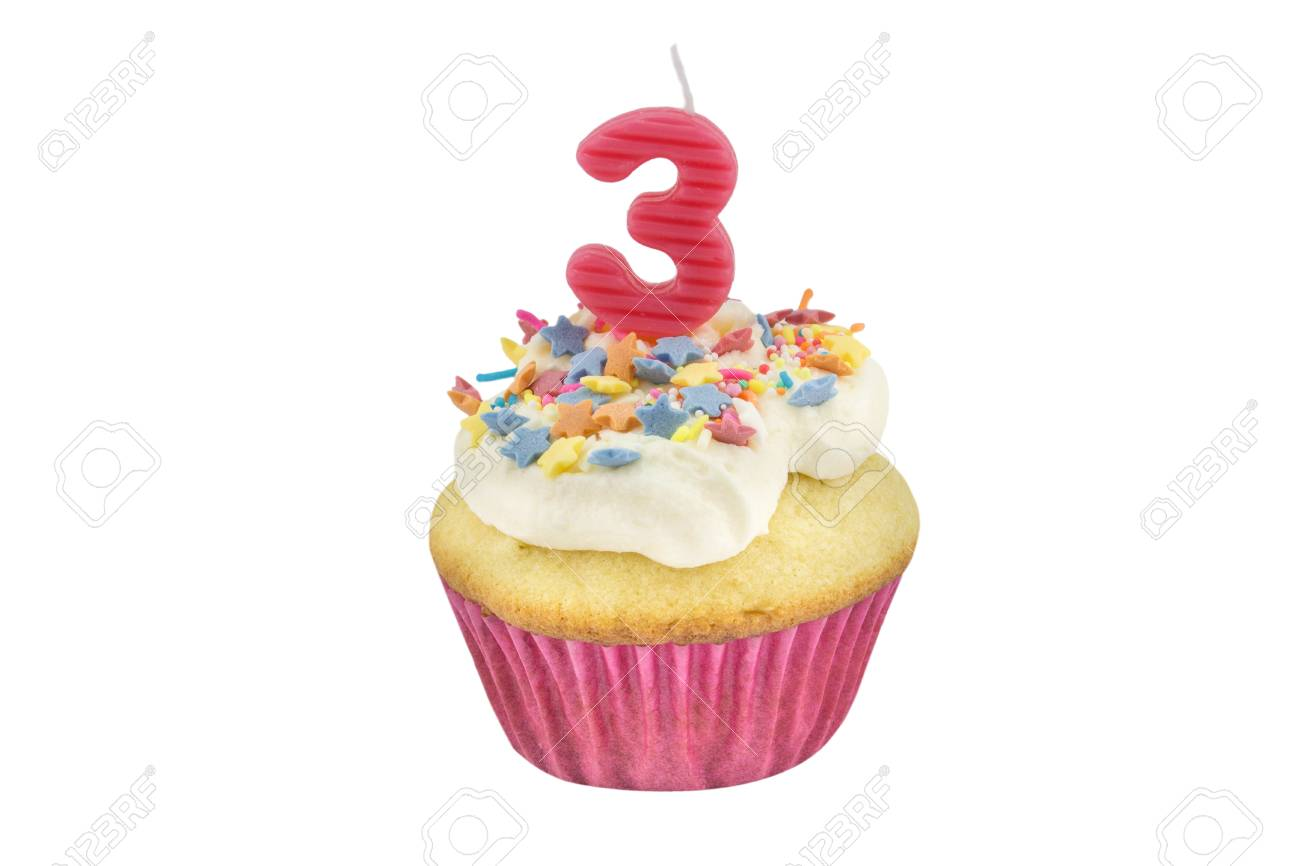 Happy Birthday Cup Cake With Star Sprinkles And Number 3 Pink Candle On White Table