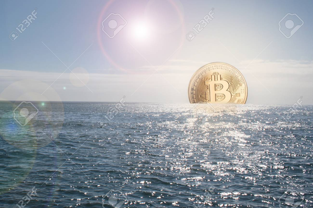 Bitcoin currency rising / sinking concept in ocean and golden bitcoin as the sun - 106929777