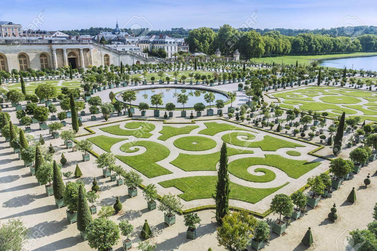 Tourists strolling the Chateau de Versailles Gardens in Paris,