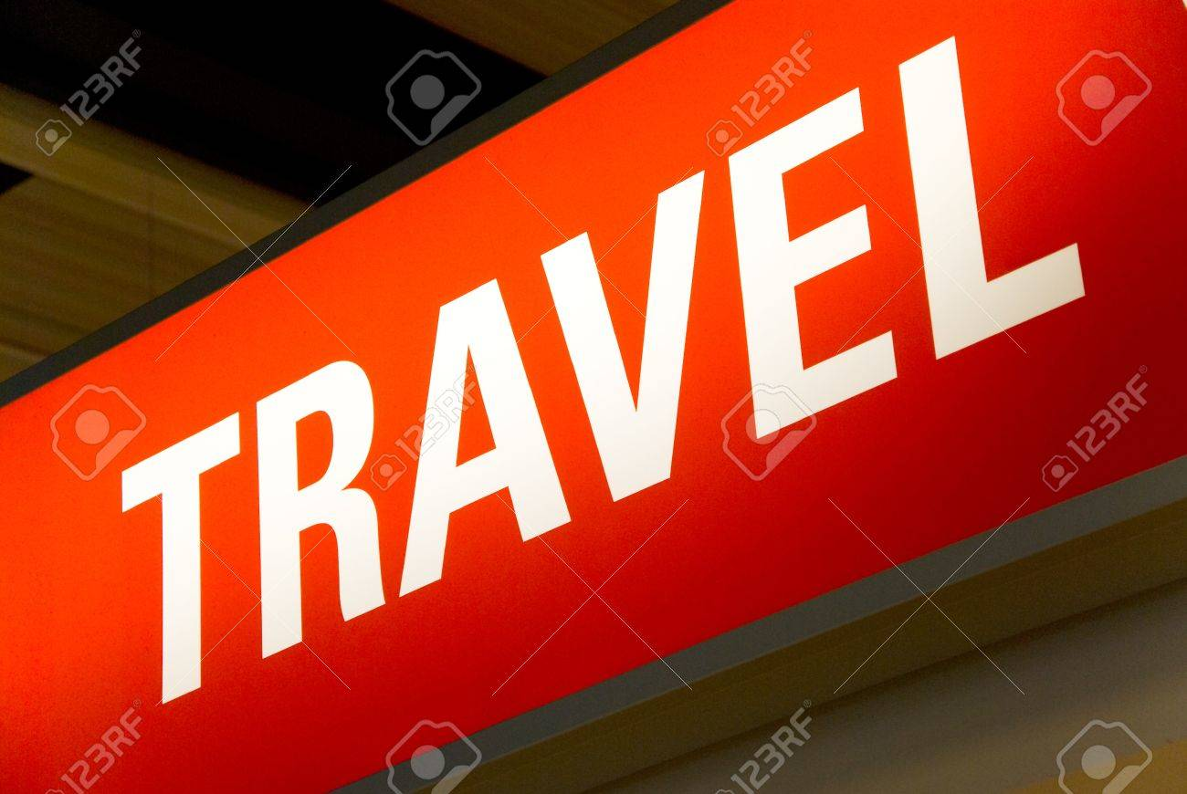 red illuminated sign with the word travel Stock Photo - 7084742