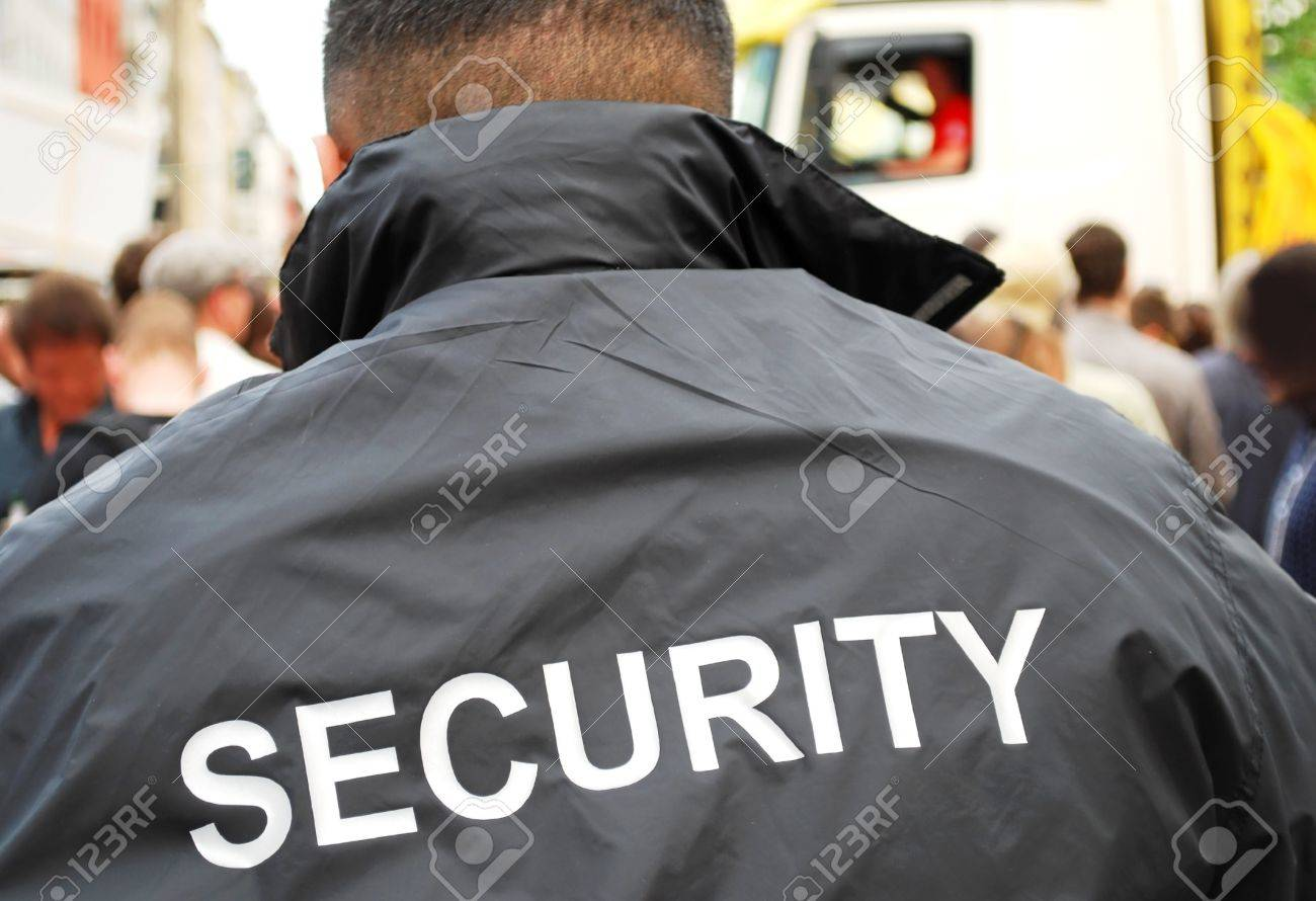 security guard in front of crowd Stock Photo - 8064532