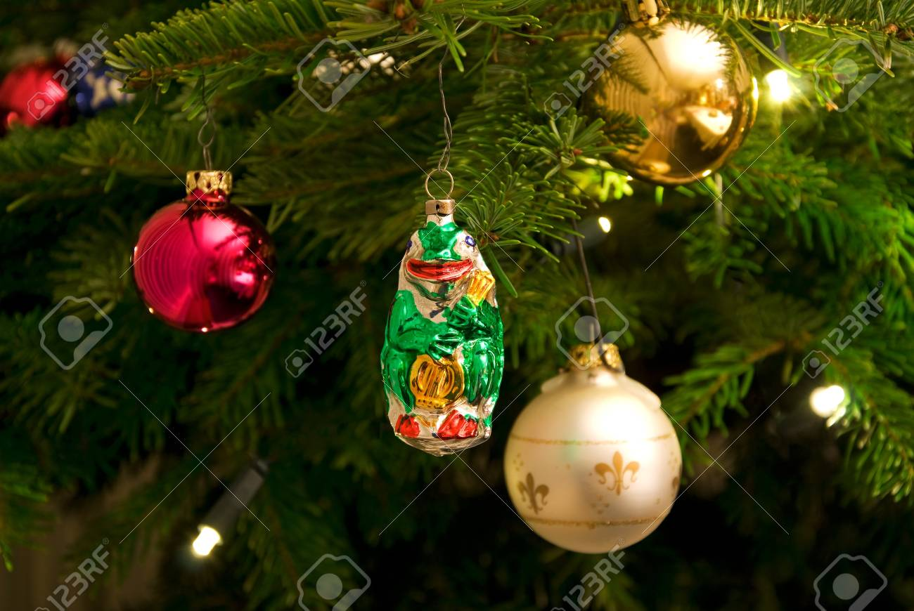 Christmas Tree With Ornaments And Electrical Candles