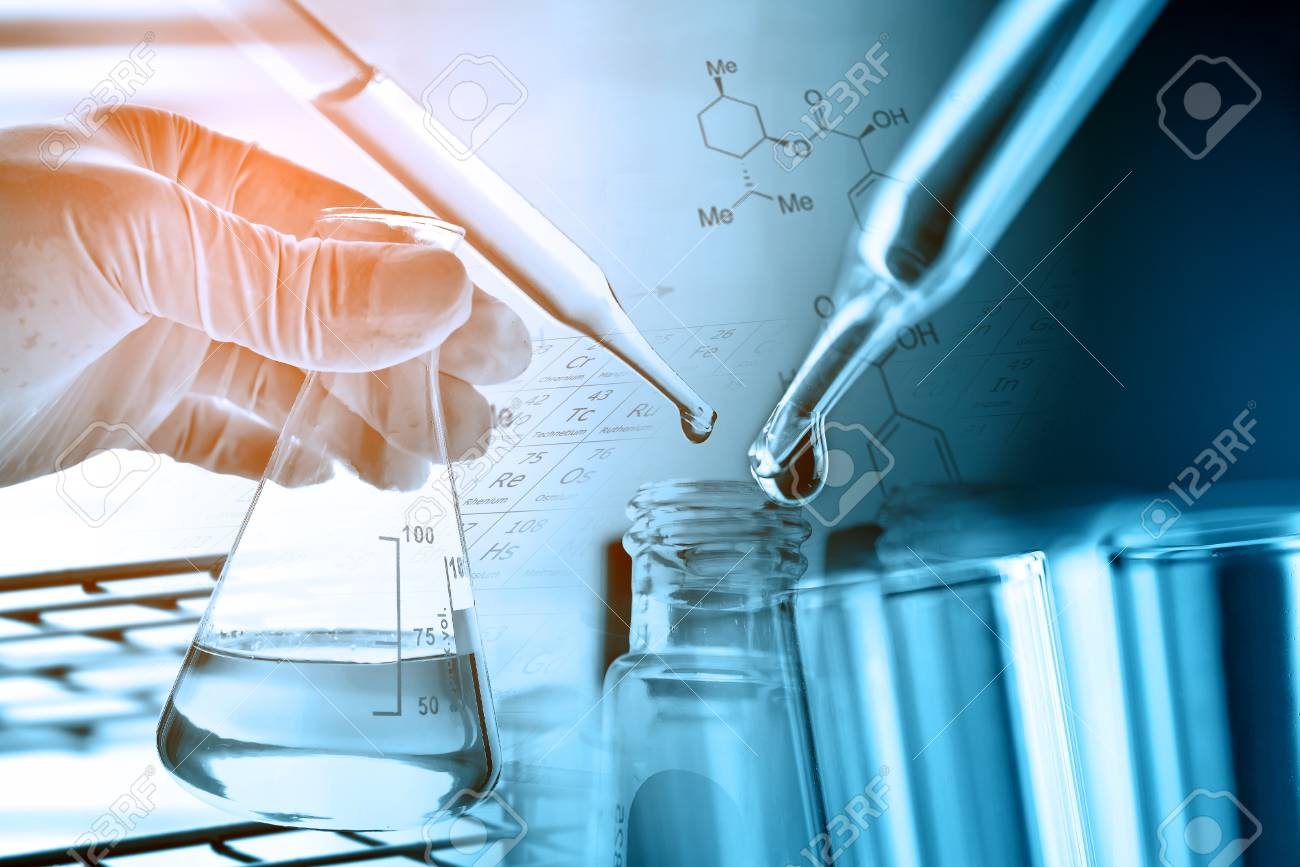 Flask in scientist hand with laboratory glassware background - 91445922