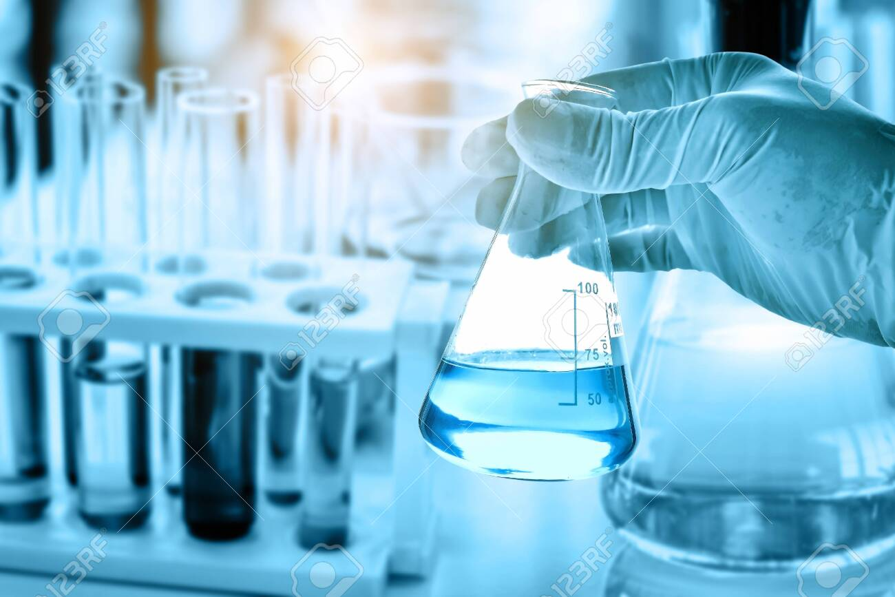 hand of scientist holding flask with lab glassware in chemical laboratory background, science laboratory research and development concept - 149709020