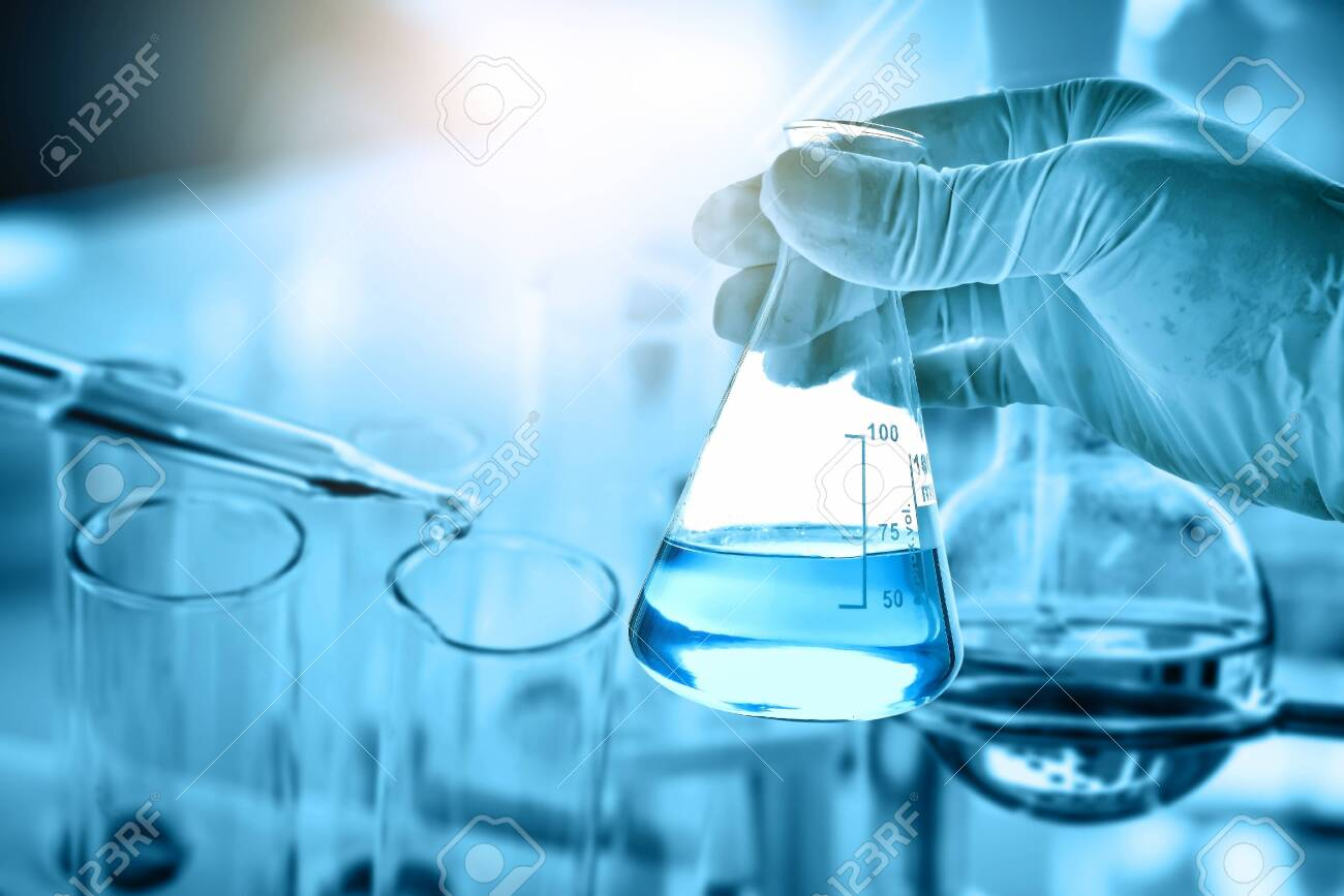 hand of scientist holding flask with lab glassware in chemical laboratory background, science laboratory research and development concept - 149708616