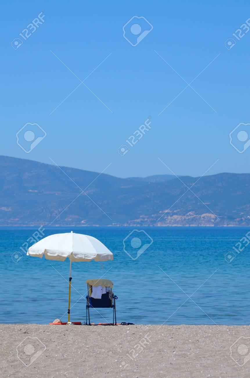 White umbrella and sunbed on a seashore Stock Photo - 11371829